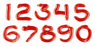 Numeri fatti di ketchup su priorità bassa bianca Fotografie Stock