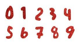 Numeri rossi e luccichio Immagini Stock