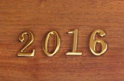 Numeri 2016 sulla porta - fondo del nuovo anno Fotografia Stock