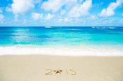 Numeri 2015 sulla sabbia - concetto di festa Immagine Stock