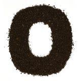 Numeri 0 zeri ha fatto di caffè grezzo a terra isolato su bianco Disposizione piana, vista superiore Immagine Stock