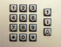 Numeric keypad. Made of metal with black digits that includes arrows and call buttons Royalty Free Stock Images