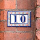 Numero civico 10 in mattonelle Fotografie Stock Libere da Diritti