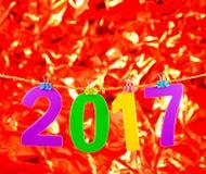 Numero del nuovo anno 2017 su fondo rosso Immagine Stock