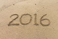 Numero dell'anno 2016 sulla sabbia Fotografia Stock Libera da Diritti