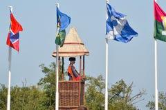Numero delle bandiere differenti con le stemme e le insegne Fotografia Stock