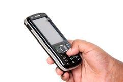 Numero di composizione della mano sul telefono delle cellule Immagini Stock Libere da Diritti