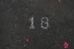 Numero diciannove 18 sulla via in pittura bianca immagine stock libera da diritti