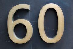 Numero elegante sessanta in oro molle su fondo scuro Immagini Stock Libere da Diritti