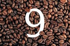 Numero nove sul concetto del fondo del chicco di caffè Fotografia Stock Libera da Diritti