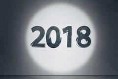 numero 2018 scritto con la luce del fuoco Immagine Stock