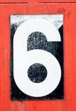 Numero sei nel nero sopra rosso Immagine Stock Libera da Diritti