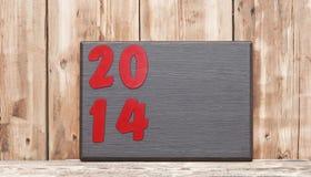 Numero 2014 sul piatto di legno Fotografia Stock Libera da Diritti