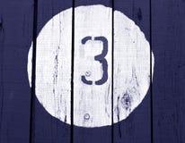 Numero tre sulla parete tonificata blu di legno Immagine Stock Libera da Diritti