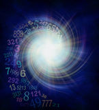Numerology Energy Vortex. Random transparent spiraling numbers swirling outwards from the center of a white star burst on a dark blue and black background with vector illustration