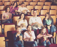 Numerous audience attending movie night with popcorn Stock Image