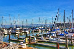 Numerous boats docked at Pier. 39 Marina during sunset stock image