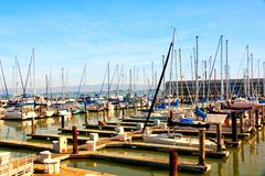 Numerous boats docked at Pier. 39 Marina during sunset royalty free stock photography