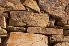 Numerous bricks of rock. Forming a natural stone wall.n of beige colourn stock photos