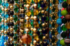 Numerous colored beads forming necklaces. Some of them out of focus. royalty free stock photos