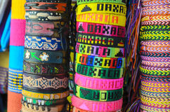 Numerous colorful wristbands with Oaxaca sight for sale at craft Stock Photography