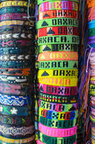 Numerous colorful wristbands with Oaxaca sight for sale at craft Royalty Free Stock Photography