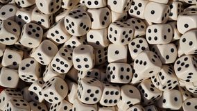 Numerous game dice. In a container in detail Royalty Free Stock Photos