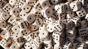Numerous game dice. In a container in detail Royalty Free Stock Photo