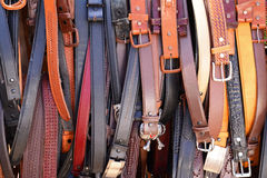 Numerous hand designed leather belts/buckles on display Stock Photo