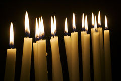 Numerous lighted table candles Royalty Free Stock Photography