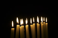 Numerous lighted table candles Stock Photography