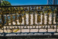 Numerous love padlocks on the fence of bridge across the Mapocho River in Santiago.Chile