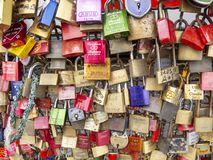 Numerous love padlocks on the fence between the footpath and the railway lines of Hohenzollern Bridge in Cologne, Germany, texture. COLOGNE, GERMANY - SEPTEMBER stock photography