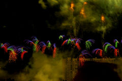 Numerous multicolored fireworks, salutes, small but unusual shapes. Scene from Fireworks festival, Competition. Scene from Fireworks Competition. Explosive Stock Photos