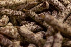 Numerous small handmade salamis stock photos