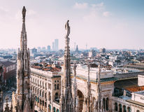 Numerous statues on steeples Duomo di Milano watches on city lif Royalty Free Stock Photos