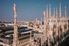 Numerous steeples with statues on Duomo di Milano main Cathedral Royalty Free Stock Photos