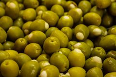Numerous stuffed olives in the market for sale royalty free stock photo