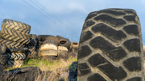 Numerous tires stacked on top of each other Royalty Free Stock Image