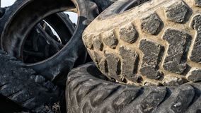 Numerous tires stacked on top of each other Stock Image
