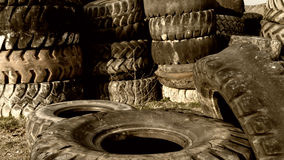 Numerous tires stacked on top of each other Stock Images