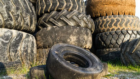 Numerous tires stacked on top of each other Stock Photo