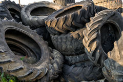 Numerous tires stacked on top of each other Stock Photography