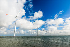 Numerous wind turbines standing in the sea Stock Image