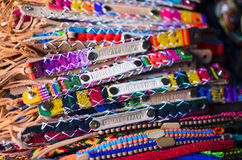 Numerous wristbands with Guatemala sing at the craft market Royalty Free Stock Images