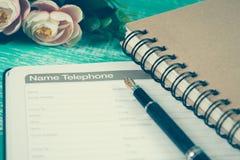 numerowa telefoniczna lista na stronie dzienniczek książki planista Obraz Stock