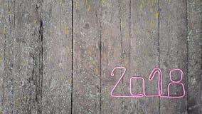 numerowy 2018 na drewnianym tle od starych desek Obrazy Stock