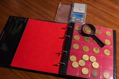 Collecting coins. Numismatics. Numismatic appreciation of a coin Stock Photography