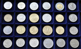Numismatic coin collection. Numismatic collection of coins on blue mat Stock Photography