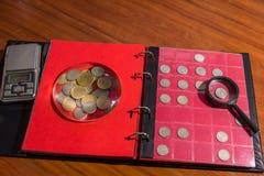 Collecting coins. Numismatics. Numismatic materials and album for coins - numismatic scene Stock Images